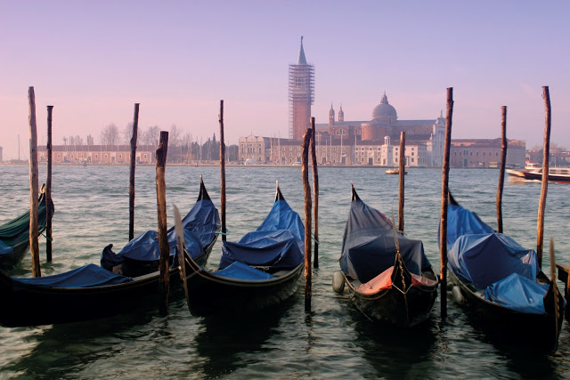 women traveling alone - gondolas in Venice