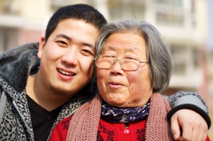 Seniors Cultural Travel - grandmother & grandson in China